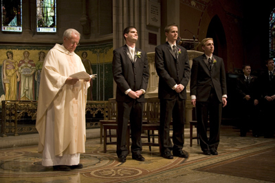 priest and groomsmen
